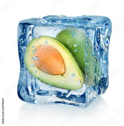 Staande foto In het ijs Avocado in ice cube