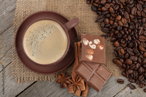 Spoed Foto op Canvas Chocolade Coffee cup with spices and chocolate on wooden table texture