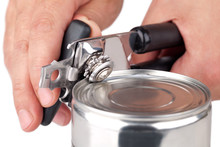 Tin Opener Opening A Can