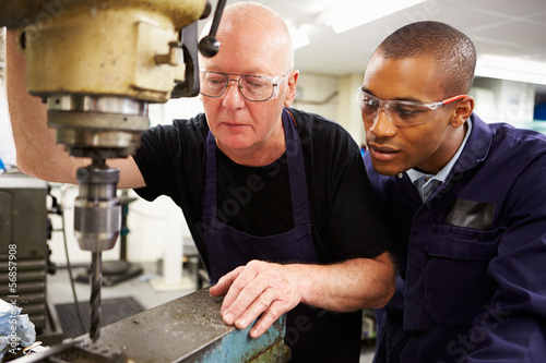 Engineer Teaching Apprentice To Use Milling Machine Wallpaper Mural