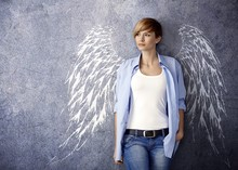 Attractive Woman With Angel Wi...
