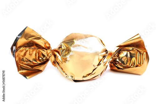 Fotografía  Chocolate candy in golden wrapper