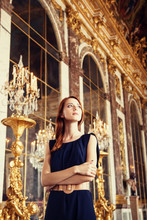 Beautiful Women In Mirror's Hall Of Versailles Chateau. France