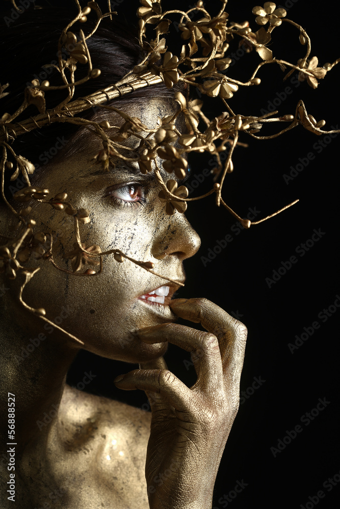 Fototapeta Beautiful Gold Painted Woman in Conceptual Beauty Themed Image