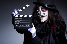 Monster With Movie Clapper Board