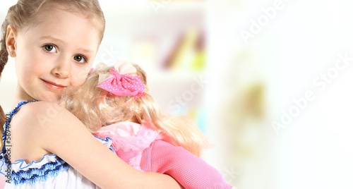 Photographie  toddler girl with doll