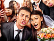 canvas print picture - Bride and groom in photobooth.