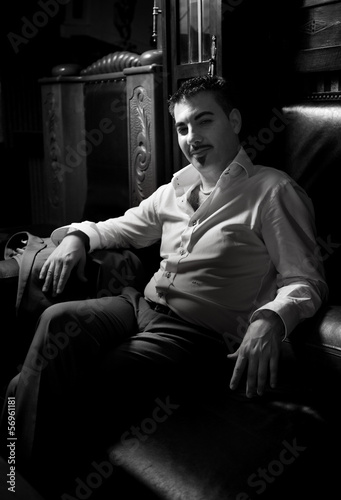 Swell Black And White Portrait Of Sexy Man Sitting On Leather Caraccident5 Cool Chair Designs And Ideas Caraccident5Info