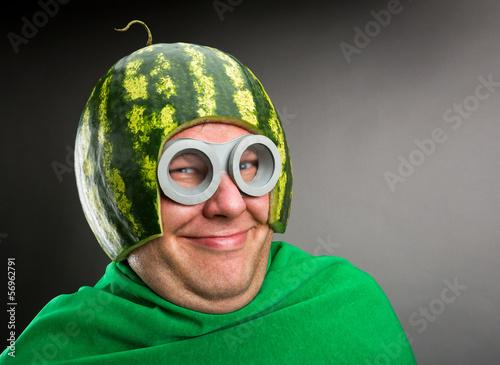 Obraz na plátně Funny man with watermelon helmet and googles