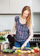 Long-haired woman cooking fish