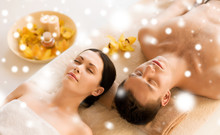 Couple In Spa Salon Lying On The Massage Desks