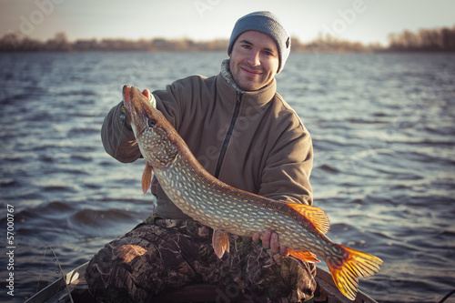 Printed kitchen splashbacks Fishing Happy angler with pike fishing trophy