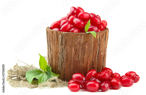 Valokuvatapetti Fresh cornel berries in wooden vase, isolated on white