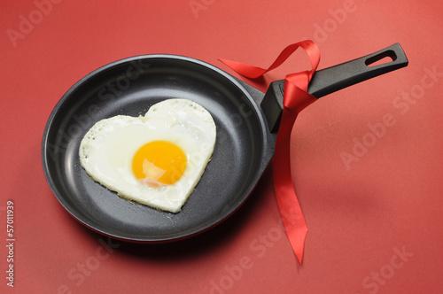 Deurstickers Gebakken Eieren Red theme Valentine heart shape egg in fry pan