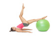Attractive sporty brunette exercising with exercise ball