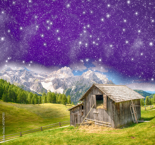 Spoed Foto op Canvas Violet Hut on mountain landscape at night