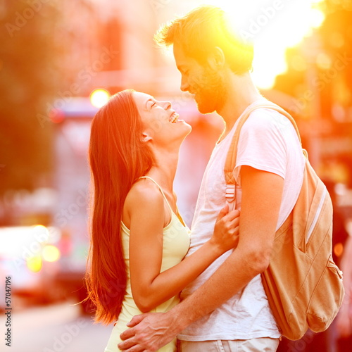 Couple in love kissing laughing having fun
