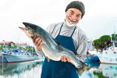 Fotografie, Obraz  Fisherman holding a big atlantic salmon fish