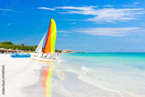 Scene with sailing boat at Varadero beach in Cuba Canvas Print