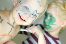 Children Coloring Their Faces ...