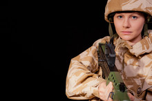 Female Soldier With SA80 Rifle
