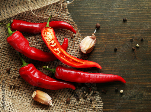 Staande foto Hot chili peppers Red hot chili peppers and garlic,