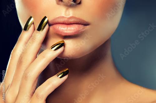 Staande foto Manicure Golden makeup and metal gold nails