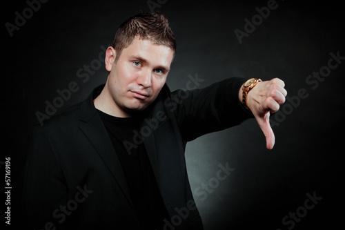 Fotografie, Obraz  disappointed man signaling thumb down