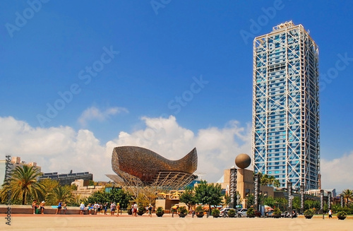 Photo Stands Barcelona BARCELONA, SPAIN - AUGUST 12: Hotel Arts and Mapfre Tower and Pe