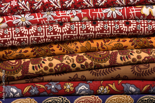 Papiers peints Affiche vintage Heap of cloth fabrics at a local market in India. Close up .