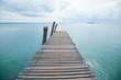 Wooden bridge into the sea.