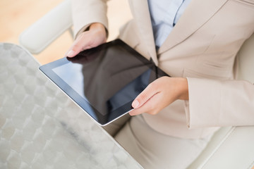Close up of a businesswoman holding a tablet pc