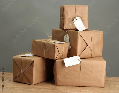 Fotografie, Obraz  parcels boxes with kraft paper,