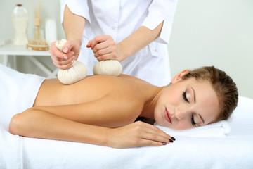 Fototapeta na wymiar Beautiful young woman having back massage close up
