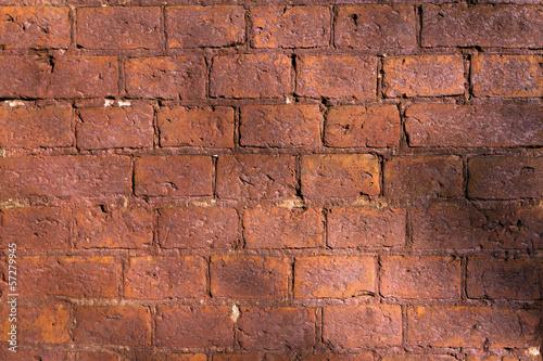 wall of dark red brick Canvas Print
