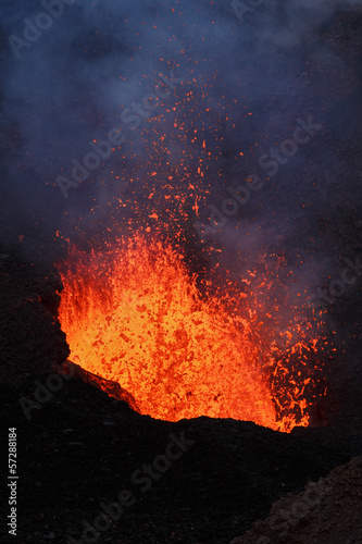 Poster de jardin Volcan Volcanic landscape of Kamchatka Peninsula: night eruption active Tolbachik Volcano - lava lake, lava flowing in crater of volcano. Russian Far East, Kamchatka Region, Klyuchevskaya Group of Volcanoes.