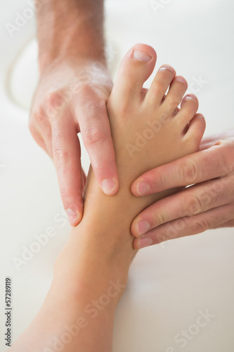 Poster Pedicure Physiotherapist kneading patients foot