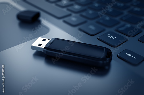 Obraz Modern USB Flash drive on laptop keyboard - fototapety do salonu