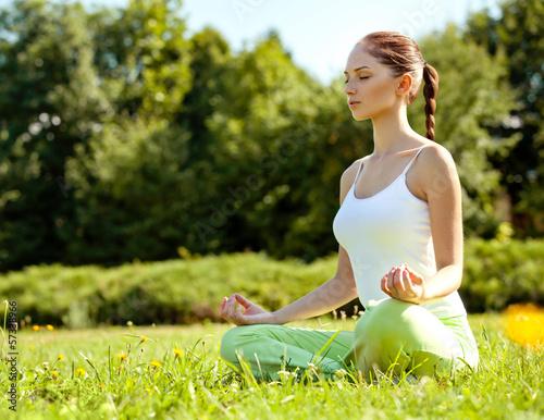 Young and beautiful woman doing yoga exercises .Yoga background