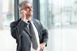 senior businessman talking on cell phone