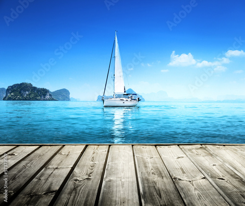 Canvas yacht and wooden platform