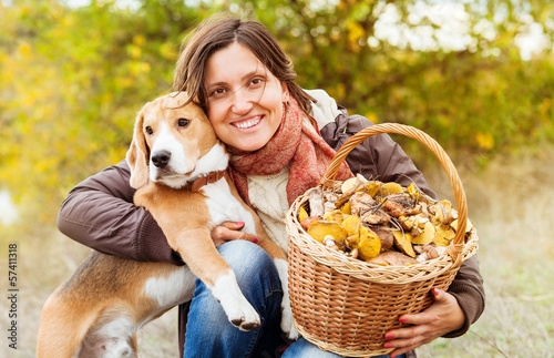 Fotografie, Obraz  Pretty woman with her favorite pet in autumn forest