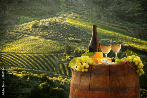 Fotobehang Wijngaard White wine with barell in vineyard, Chianti, Tuscany, Italy