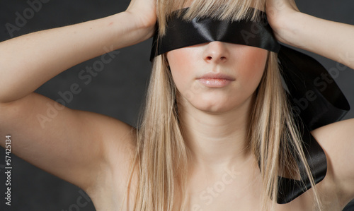 Fotografie, Obraz  Mysterious beautiful face with ribbon blindfold on eyes