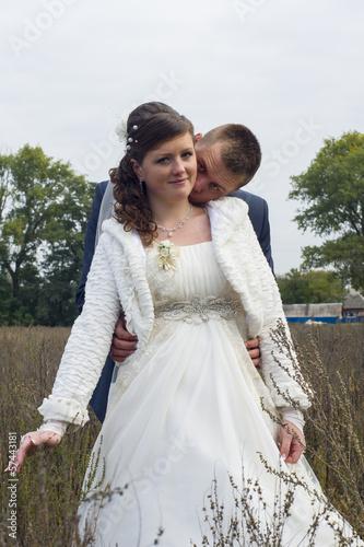 Fotografie, Obraz  bridal couple walks in autumn