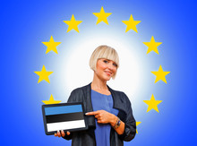 Woman Holding Tablet With Estonian Flag On European Union Backg
