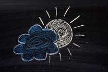 Chalk Drawing Of The Sun And A...