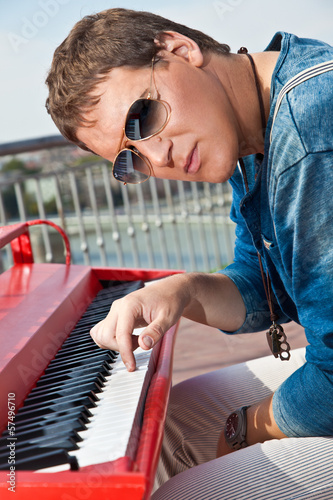 Fotografie, Obraz  Young pianist play on his piano with bright emotions,