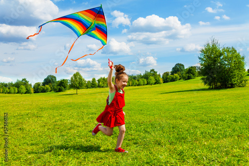 6 years old girl with kite Wallpaper Mural