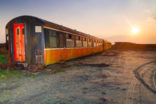Derailed Train At Sunset In Ireland